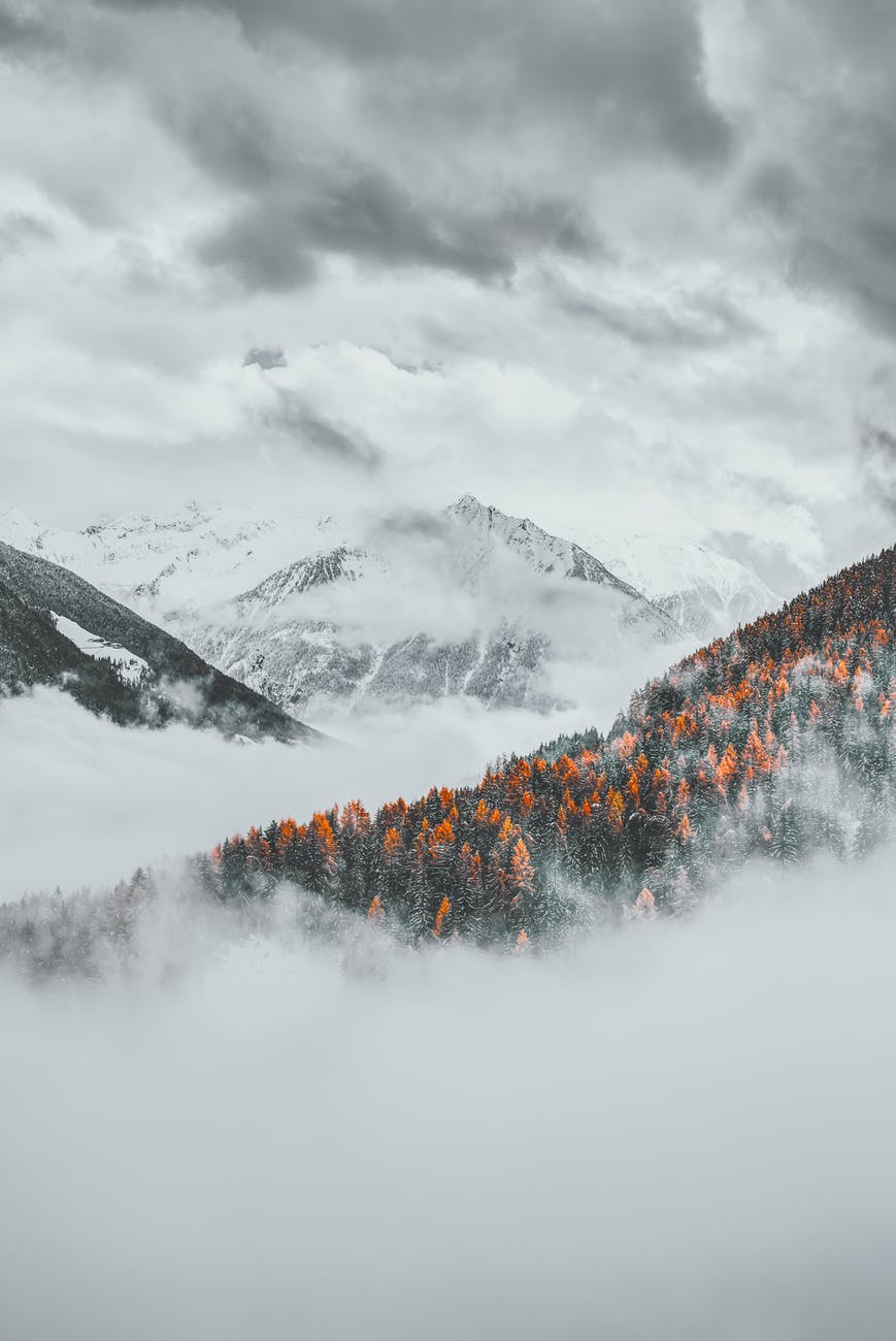 snow capped mountain under cloudy sky